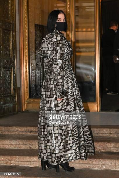Leigh Lezark is seen wearing a black and white print rain coat outside the Christian Siriano show during New York Fashion Week F/W21 on February 25,...