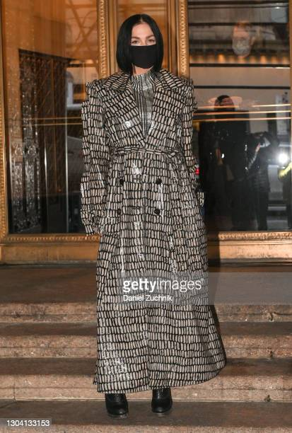 Leigh Lezark is seen wearing a black and white print rainoutside the Christian Siriano show during New York Fashion Week F/W21 on February 25, 2021...