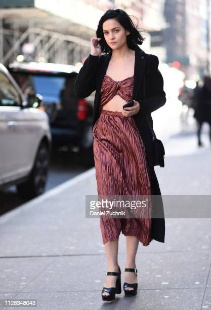 Leigh Lezark is seen wearing a pink top and skirt with a black coat outside the Jason Wu show during New York Fashion Week: Fall/Winter 2019 on...