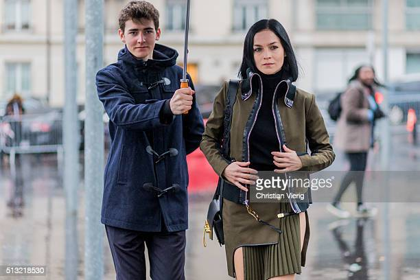 March 1: Leigh Lezark is seen wearing an olive green military style jacket with leather accents and an olive green pleated wrap skirt outside Anthony...