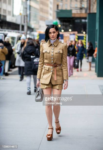 Leigh Lezark is seen wearing camel jacket and shorts brown belt outside Michael Kors during New York Fashion Week Fall / Winter 2020 on February 12...