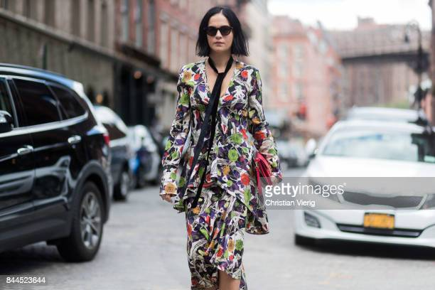 Leigh Lezark wearing a dress with floral print seen in the streets of Manhattan outside Jason Wu during New York Fashion Week on September 8 2017 in...