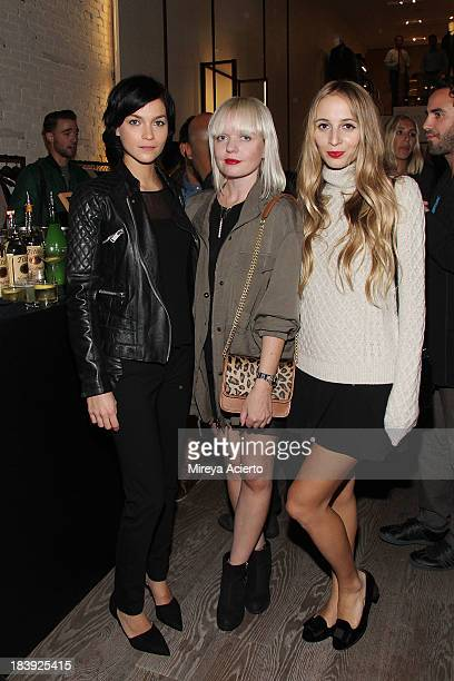 Leigh Lezerk Fiona Byrne and Harley Viera Newton attends the Vince Flagship Store on October 9 2013 in New York City