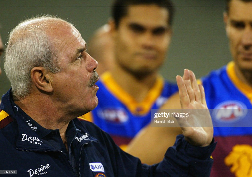 Leigh Matthews coach of Brisbane addresses his team at quarter time during the AFL Second Qualifying Final between the Collingwood Magpies and the Brisbane Lions at the Melbourne Cricket Ground on September 6, 2003 in Melbourne, Australia.