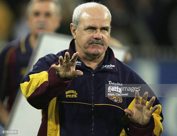 Leigh Matthews coach of the Lions addresses his players at quarter time during the AFL Second Preliminary Final match between the Brisbane Lions and...