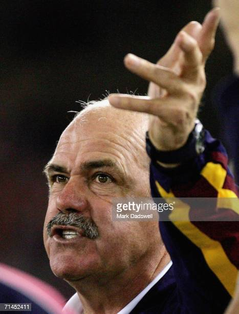 Leigh Matthews Coach of the Lions addresses his players during the round 15 AFL match between the Kangaroos and the Brisbane Lions at the Telstra...