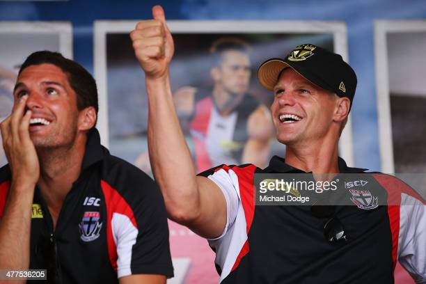 Leigh Montagna and Nick Riewoldt react during a St Kilda Saints AFL Fan Day at Frankston Foreshore on March 10 2014 in Melbourne Australia
