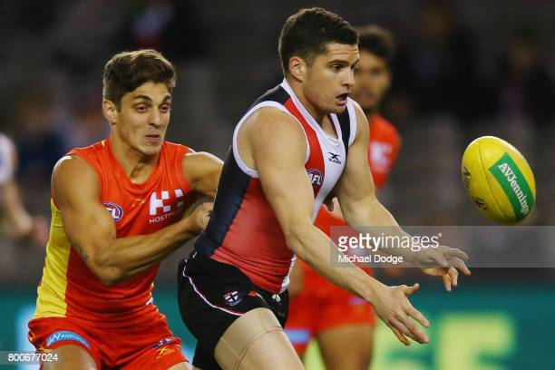 Leigh Montagna of the Saints handballs during the round 14 AFL match between the St Kilda Saints and the Gold Coast Suns at Etihad Stadium on June 25...