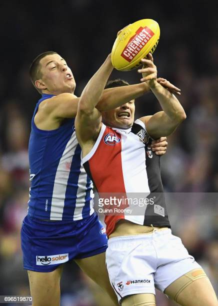 Leigh Montagna of the Saints marks infront of Nathan Hrovat of the Kangaroos during the round 13 AFL match between the North Melbourne Kangaroos and...