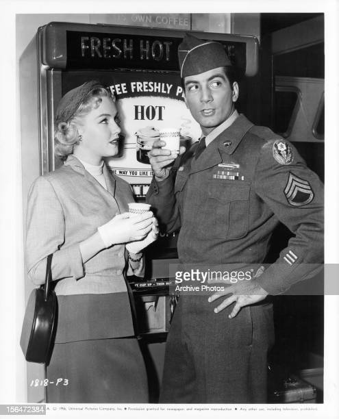 Leigh Snowden and Ray Danton having a cup of coffee in between scenes from the film 'Outside The Law' 1956