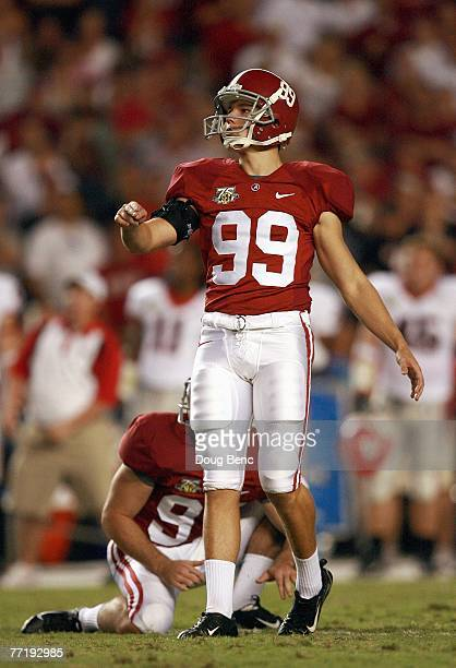 Leigh Tiffin of the Alabama Crimson Tide follows his field goal kick against the Georgia Bulldogs at BryantDenny Stadium September 22 2007 in...