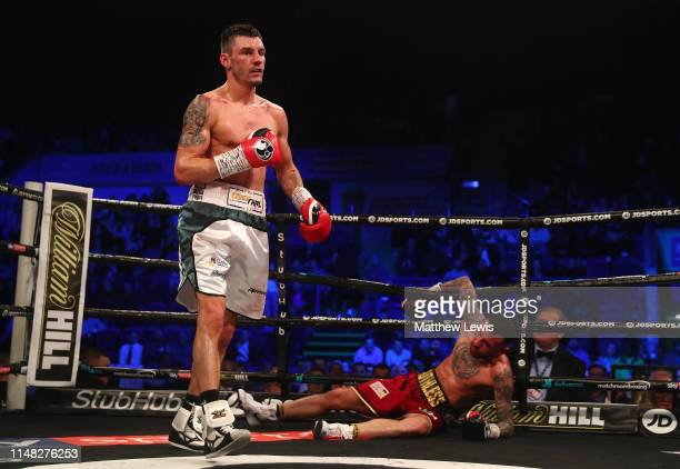 Leigh Wood of England knocks down Ryan Doyle of England during the Commonwealth Featherweight Championship fight during the JD NXTGEN Series at...