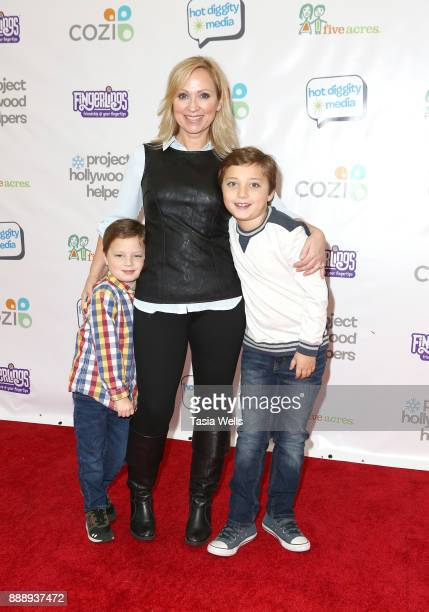 LeighAllyn Baker and children at Project Hollywood Helpers at Skirball Cultural Center on December 9 2017 in Los Angeles California