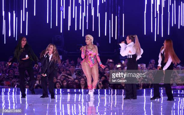 LeighAnne Pinnock and Jade Thirlwall of Little Mix Nicki Minaj Perrie Edwards and Jesy Nelson of Little Mix perform on stage during the MTV EMAs 2018...