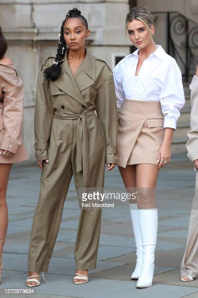 LeighAnne Pinnock and Perrie Edwards from Little Mix seen leaving the Langham Hotel ahead of their performance of BBC Radio One Live Lounge on...