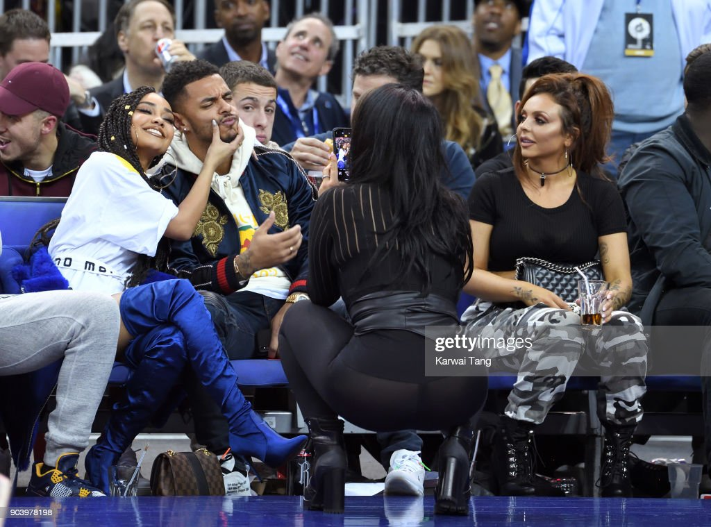 Leigh-Anne Pinnock (L), Andre Gray (2nd L) and Jesy Nelson (R) attend the Philadelphia 76ers and Boston Celtics NBA London game at The O2 Arena on January 11, 2018 in London, England.