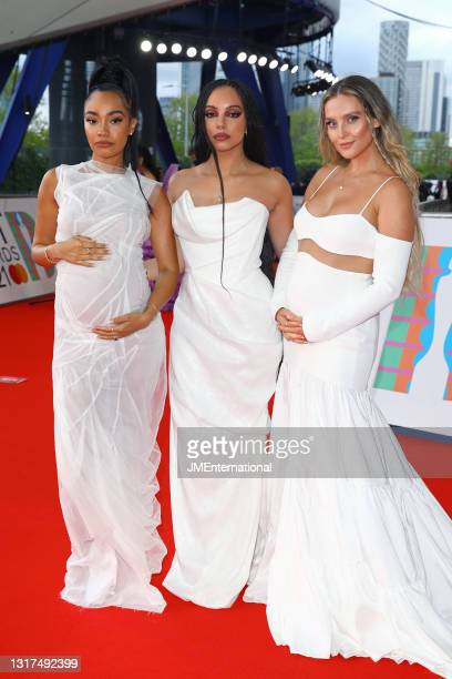 Leigh-Anne Pinnock, Jade Thirlwall and Perrie Edwards of Little Mix arrive at The BRIT Awards 2021 at The O2 Arena on May 11, 2021 in London, England.