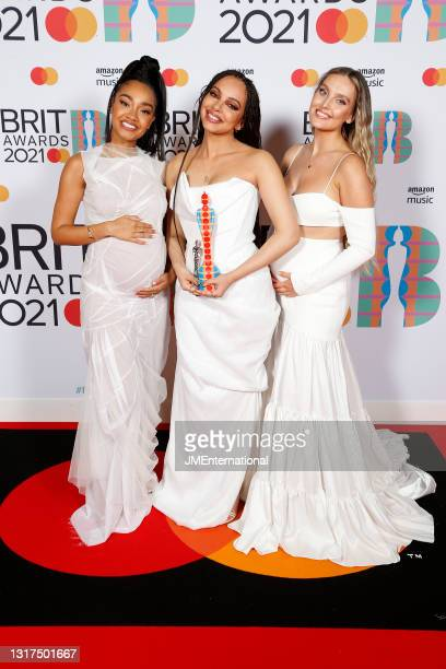Leigh-Anne Pinnock, Jade Thirlwall and Perrie Edwards of Little Mix pose with their British Group award in the media room during The BRIT Awards 2021...