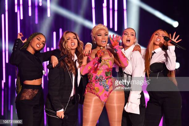 LeighAnne Pinnock Jade Thirlwall Nicki Minaj Perrie Edwards and Jesy Nelson of Little Mix perform on stage during the MTV EMAs 2018 on November 4...