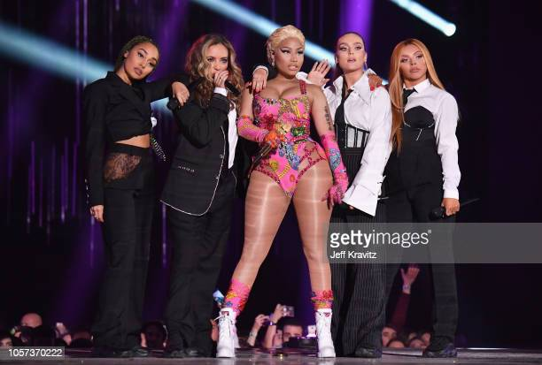 LeighAnne Pinnock Jade Thirlwall Perrie Edwards and Jesy Nelson of Little Mix perform on stage with Nicki Minaj during the MTV EMAs 2018 on November...