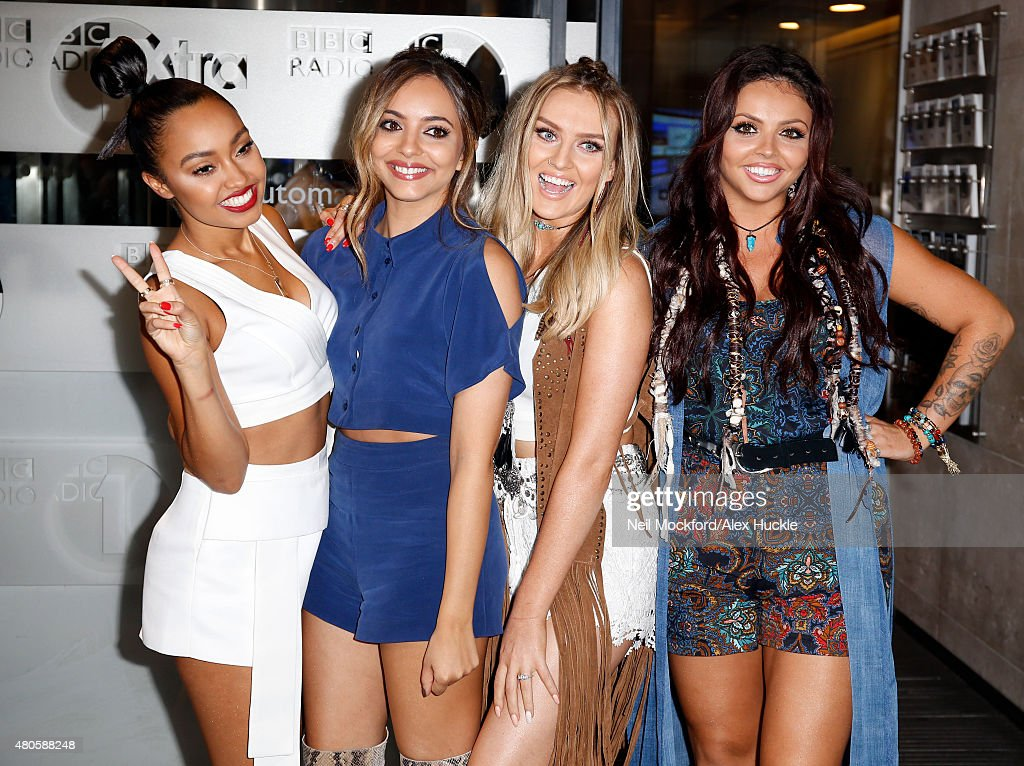 Leigh-Anne Pinnock, Jade Thirlwall, Perrie Edwards and Jesy Nelson of Little Mix pose for pictures was they leave the BBC Radio 1 Studios on July 13, 2015 in London, England. Photo by Neil Mockford/Alex Huckle/GC Images)