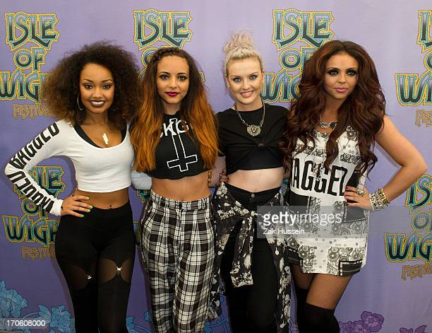 LeighAnne Pinnock Jesy Nelson Perrie Edwards and Jade Thirlwall of Little Mix on day 3 of the Isle of Wight Festival at Seaclose Park on June 15 2013...