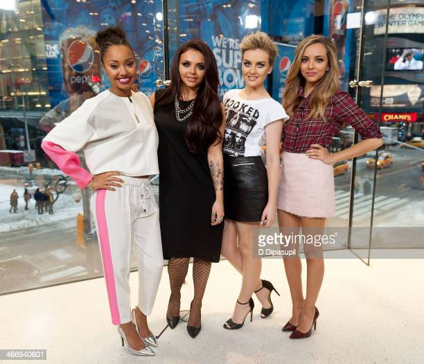 LeighAnne Pinnock Jesy Nelson Perrie Edwards and Jade Thirlwall of Little Mix visit Extra at their HM Studio in Times Square on February 5 2014 in...
