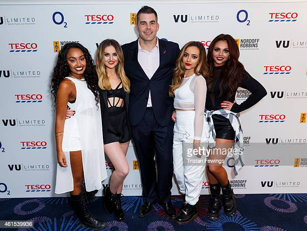 LeighAnne Pinnock Perrie Edwards Jade Thirlwall and Jesy Nelson of Little Mix pose with Nick Easter at the Nordoff Robbins Six Nations Championship...