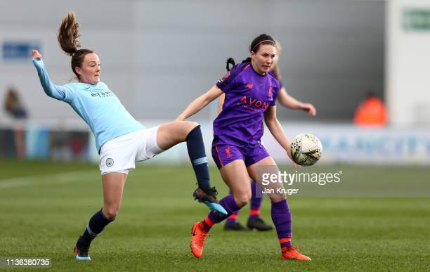 LeighAnne Robe of Liverpool holds off Caroline Weir of Manchester City during the SSE Women's FA Cup Quarter Final match between Manchester City...