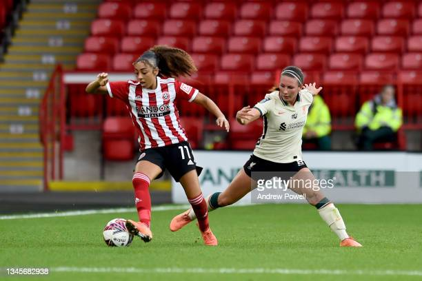Leighanne Robe of Liverpool Women competing with Jess Clarke of Sheffield United Women during the Barclays FA Women's Championship match between...