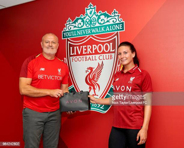Leighanne Robe poses for a photo with Neil Redfearn Liverpool Ladies manager after signing for Liverpool Ladies at Anfield on June 25 2018 in...