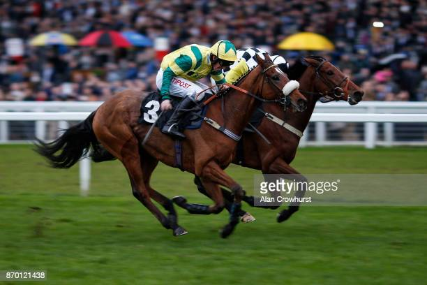 Leighton Aspell riding Jersey Bean win The Thames Materials Standard Open National Hunt Flat Race at Ascot racecourse on November 4 2017 in Ascot...
