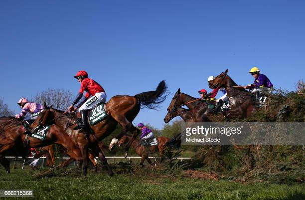 Leighton Aspell riding Lord Windermere jumps with Derek Fox riding One For Arthur and Charlie Deutsch riding Houblon Des Obeaux during the 2017...