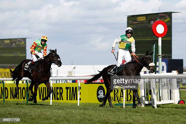 Leighton Aspell riding Many Clouds win The Crabbie's Grand National Steeple Chase from Saint Are on Crabbie's Grand National day at Aintree...