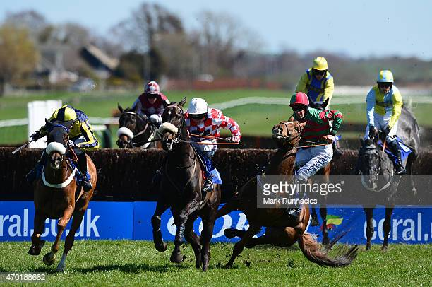 Leighton Aspell riding Puffin Billy romps to victory as Brian Hughes riding Runswick Royal falls at the last fence during The Weatherbys Private...