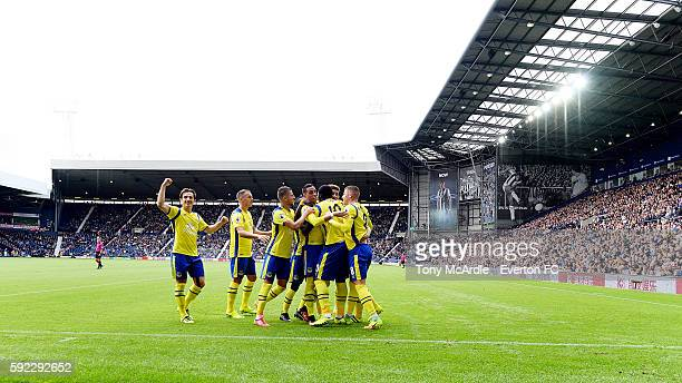 Leighton Baines acknowledges the fans as his team mates mob goalscorer Gareth Barry as he celebrates his goal with team mates during the Premier...