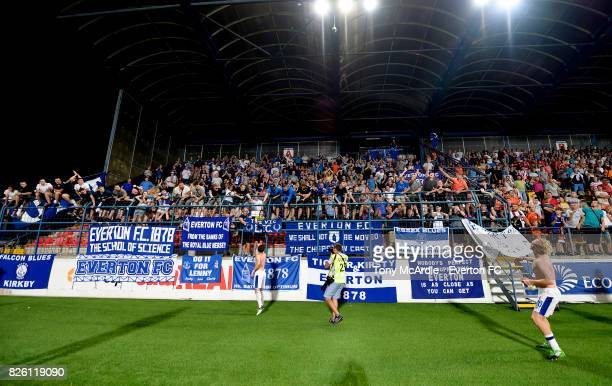 Leighton Baines and Tom Davies throw their shirts into the fans during UEFA Europa League Qualifier match between MFK Ruzomberok and Everton on...