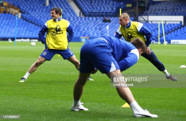 Leighton Baines and Tony Hibbert of Everton stretch during an Everton training session at Goodison Park on April 3, 2012 in Liverpool, England.