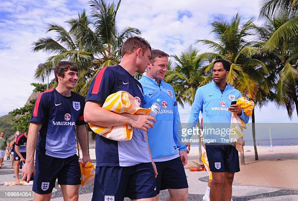 Leighton baines, James Milner, Wayne Rooney and Joleon Lescott walk back to the hotel after the England team warm down session on Copacabana Beach...