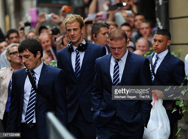 Leighton Baines, Joe Hart, Wayne Rooney and Alex Oxlade Chamberlain of England board the team bus at the Hotel Stary on June 25, 2012 in Krakow,...