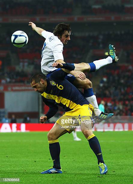 Leighton Baines of England outjumps Emir Bajrami of Sweden during the international friendly match between England and Sweden at Wembley Stadium on...