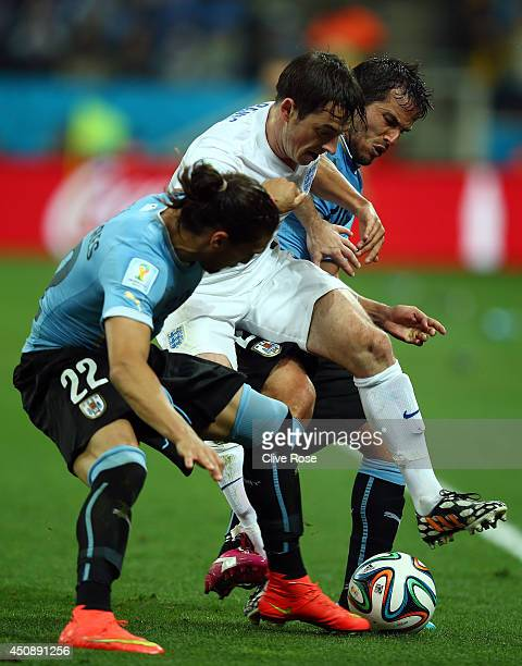 Leighton Baines of England takes on Martin Caceres and Alvaro Gonzalez of Uruguay during the 2014 FIFA World Cup Brazil Group D match between Uruguay...