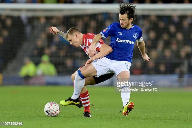 Leighton Baines of Everton and Harry Anderson challenge for the ball during the Emirates FA Cup Third Round match between Everton and Lincoln City at...