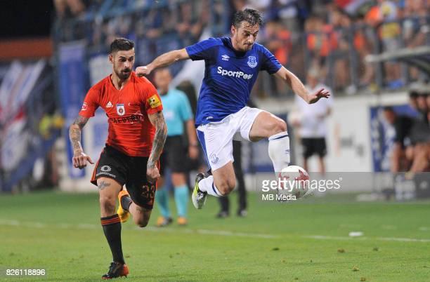 Leighton Baines of Everton and Matus Macik of Ruzomberok in action during the UEFA Europa League Qualifier between MFK Ruzomberok and Everton on...