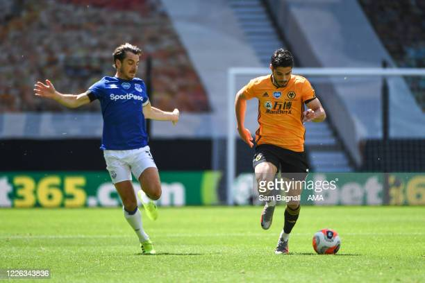 Leighton Baines of Everton and Pedro Neto of Wolverhampton Wanderers during the Premier League match between Wolverhampton Wanderers and Everton FC...