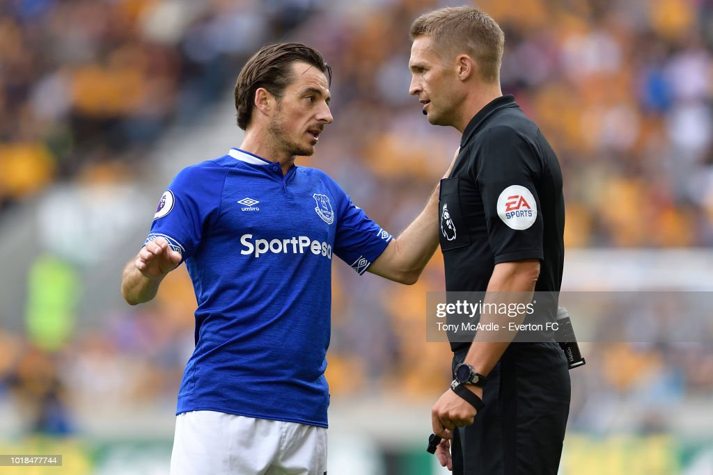 Leighton Baines of Everton and referee Craig Pawson (R) during the Premier League match between Wolverhampton Wanderers and Everton FC at Molineux on August 11, 2018 in Wolverhampton, England.