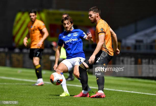 Leighton Baines of Everton battles for possession with Matt Doherty of Wolverhampton Wanderers during the Premier League match between Wolverhampton...