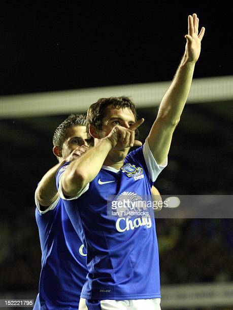 Leighton Baines of Everton celebrates after scoring the opening goal during The Barclays Premier League match between Everton and Newcastle United at...