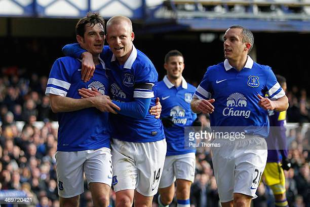 Leighton Baines of Everton celebrates his goal with team mates Steven Naismith and Leon Osman during the FA Cup Fifth Round match between Everton and...