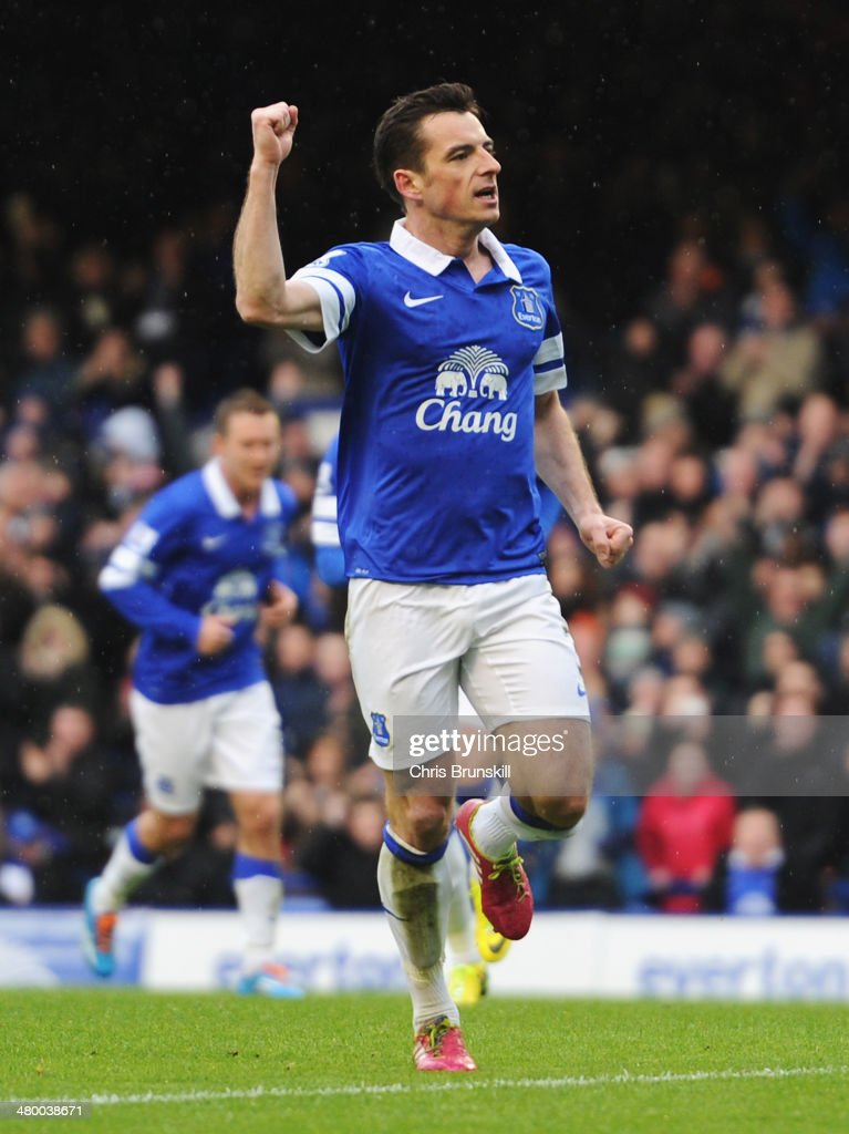 Leighton Baines of Everton celebrates scoring from the penalty spot during the Barclays Premier League match between Everton and Swansea City at Goodison Park on March 22, 2014 in Liverpool, England.